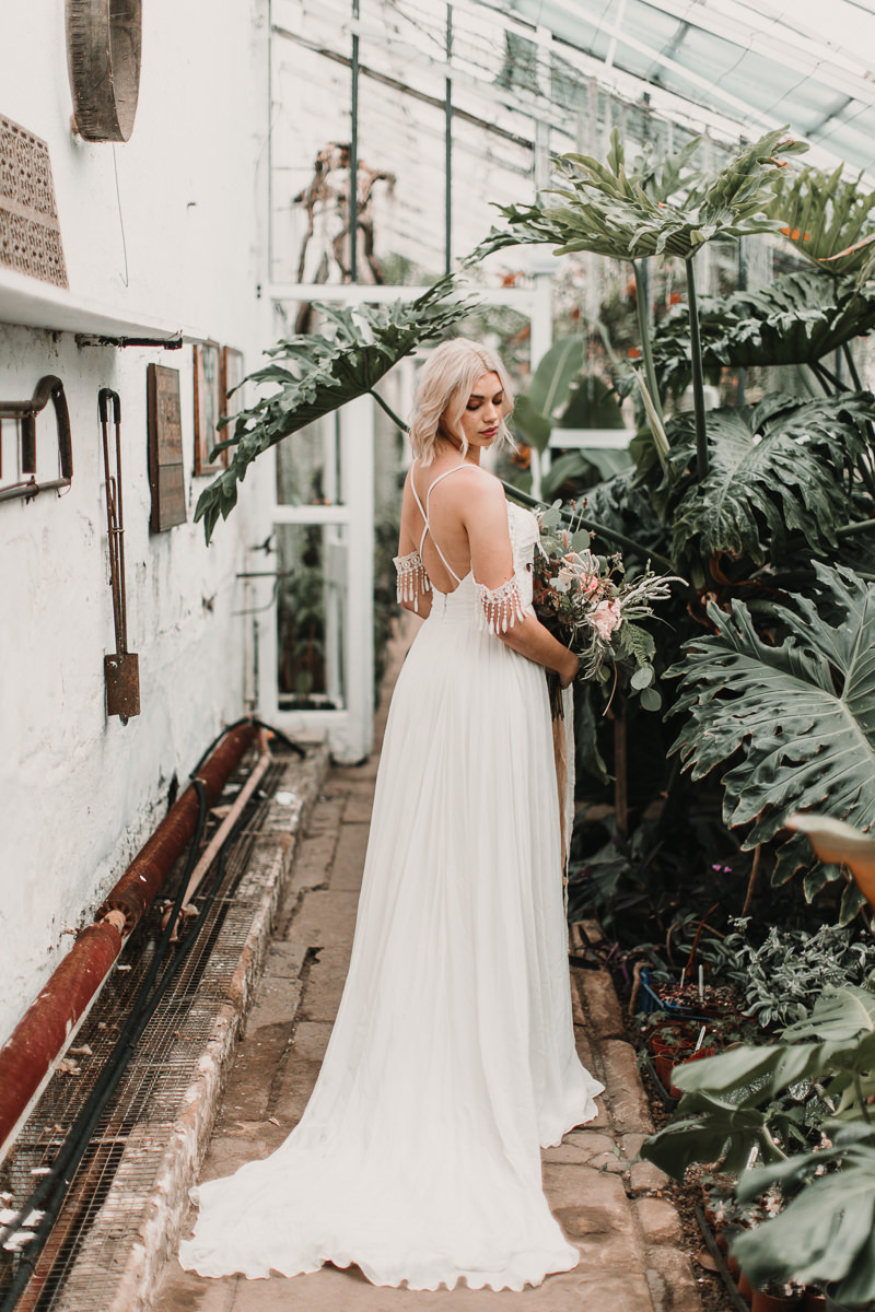 The back and detailing of this boho wedding dress with tassels is just to most heavenly combination. Blush and green Bohemian Wedding Inspiration bringing a little California to you where ever you are in the world. Relaxed styling and desert inspiration and vibes. Wedding ideas for boho brides who an effortlessly relaxed, bohemian wedding. Shot by Natalie Pluck Photography. See full blog post for credits and more inspiration here https://www.nataliepluck.com/bohemian-wedding-inspiration/ 