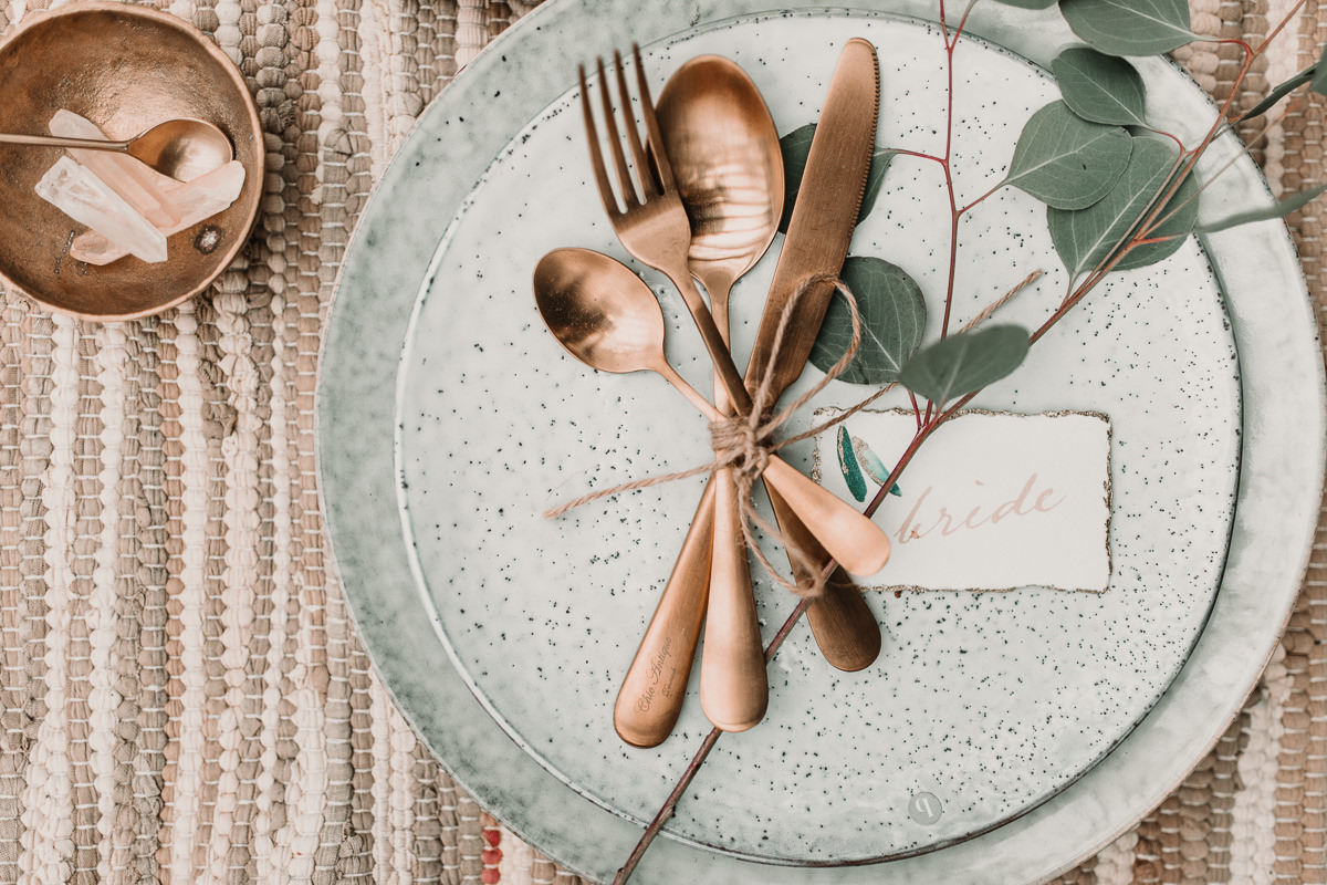 Brushed copper table details and rustic settings. Blush and green Bohemian Wedding Inspiration bringing a little California to you where ever you are in the world. Relaxed styling and desert inspiration and vibes. Wedding ideas for boho brides who an effortlessly relaxed, bohemian wedding. Shot by Natalie Pluck Photography. See full blog post for credits and more inspiration here https://www.nataliepluck.com/bohemian-wedding-inspiration/ 