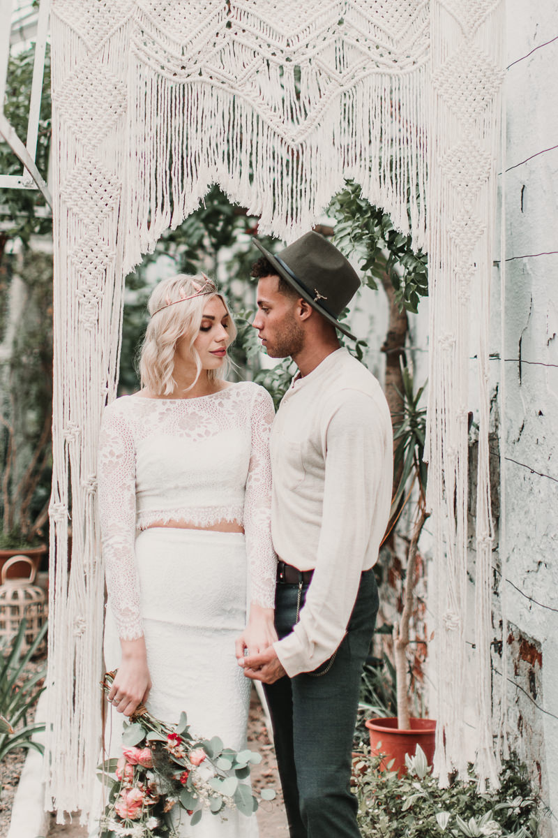 Macrame wedding arch of dreams. Blush and green Bohemian Wedding Inspiration bringing a little California to you where ever you are in the world. Relaxed styling and desert inspiration and vibes. Wedding ideas for boho brides who an effortlessly relaxed, bohemian wedding. Shot by Natalie Pluck Photography. See full blog post for credits and more inspiration here https://www.nataliepluck.com/bohemian-wedding-inspiration/ 
