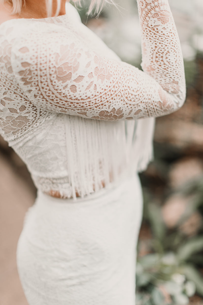 This boho Shikoba Bride wedding dress with tassels is to die for! Blush and green Bohemian Wedding Inspiration bringing a little California to you where ever you are in the world. Relaxed styling and desert inspiration and vibes. Wedding ideas for boho brides who an effortlessly relaxed, bohemian wedding. Shot by Natalie Pluck Photography. See full blog post for credits and more inspiration here https://www.nataliepluck.com/bohemian-wedding-inspiration/ 