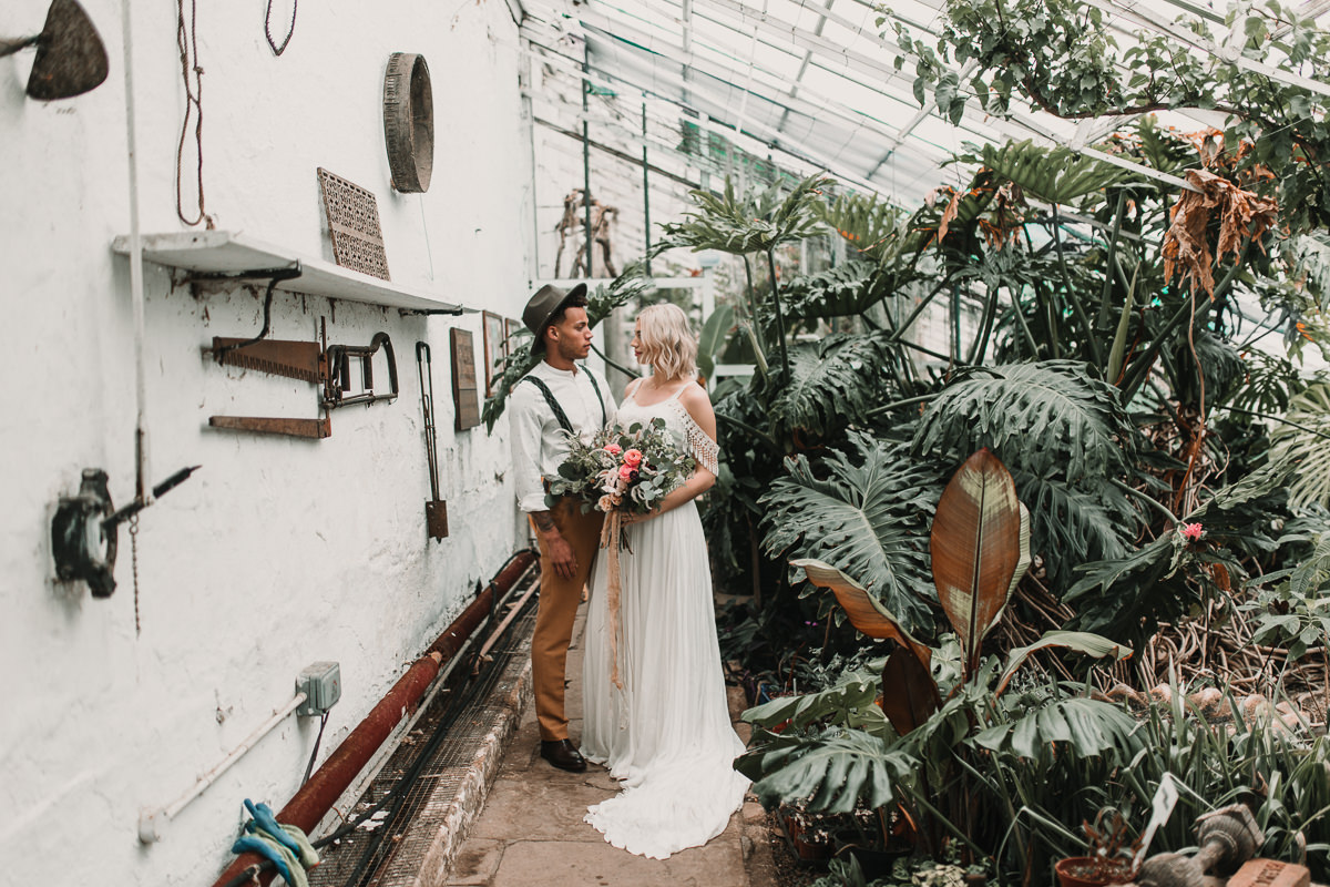 Laid back groom styling and tasselled Shikoba Bride wedding dress. Blush and green Bohemian Wedding Inspiration bringing a little California to you where ever you are in the world. Relaxed styling and desert inspiration and vibes. Wedding ideas for boho brides who an effortlessly relaxed, bohemian wedding. Shot by Natalie Pluck Photography. See full blog post for credits and more inspiration here https://www.nataliepluck.com/bohemian-wedding-inspiration/ 