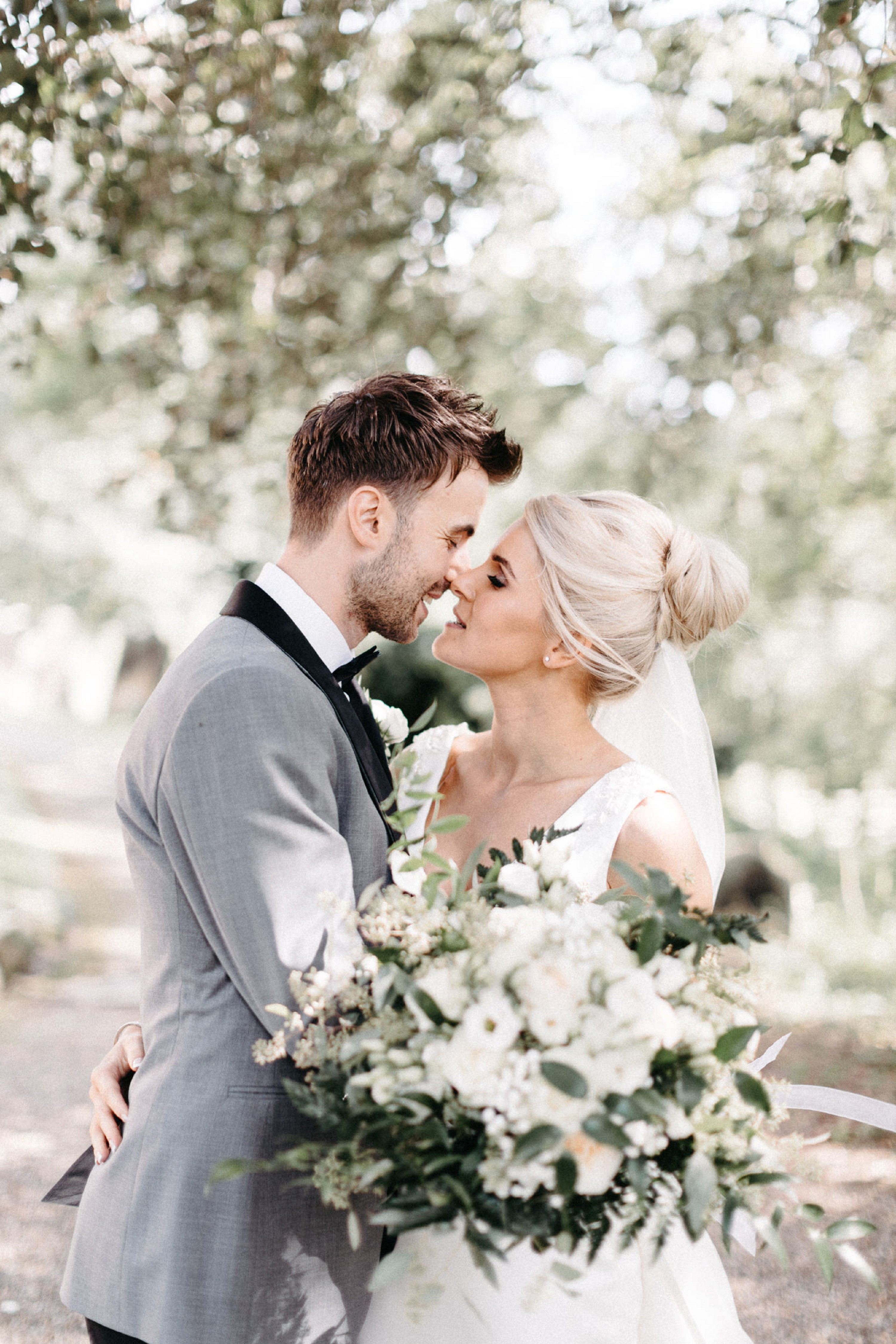 The Elegant Yorkshire Wedding of Eva + Charles in Hutton Rudby, North Yorkshire. A beautiful marquee wedding with chic decor. Minimal, elegant dress from Pronvias with stunning silhouette and over skirt. Simple, minimalist styling and muted colour palette. Wedding inspiration goals Photographed by Natalie Pluck. To see more of this wedding click the link: https://www.nataliepluck.com/elegant-yorkshire-wedding/ #elegantyorkshirewedding #yorkshirewedding #yorkshireweddingphotographer #yorkshireweddingphotography #bestyorkshireweddingphotographer #bestyorkshirephotographer #yorkshireweddinginspo #northyorkshirewedding #elegantwedding #elegantweddingphotography #margqeewedding #pronoviaswedding #pronovias #weddinginspiration