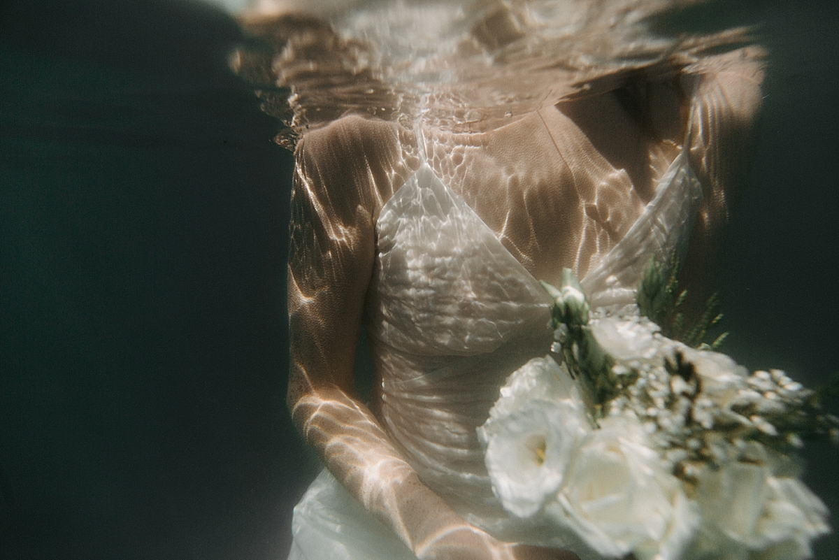 Underwater wedding portraits in Lake Zurich by Natalie Pluck. Dreamy and ethereal underwater wedding photography. White polka dot wedding dress from Zara. Adventure sessions for romantic couples looking for something uniquely them. See the full shoot at www.nataliepluck.com/underwater-wedding-portraits #underwater #underwaterwedding #underwaterportraits #lakewedding #lakeweddingportraits #zurichwedding #zurichportraits #lakezurich #adventuresession #unusualwedding #alternativewedding #lakewedding #waterwedding